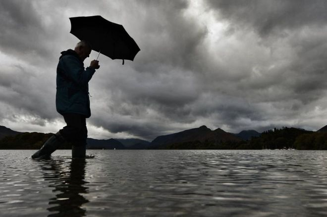 ££50-AVOID-USING-IF-POS-A-walker-takes-a-stroll-along-the-side-of-Derwentwater-in-the-Lake-District